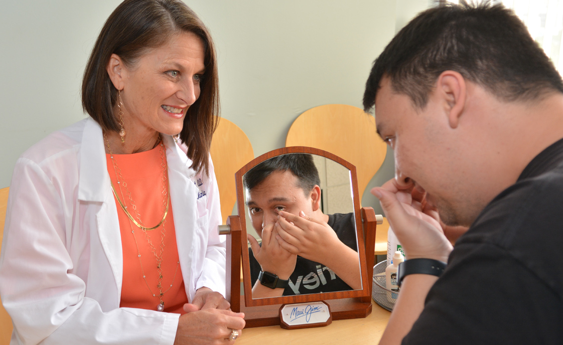 Dr Jenifer Bossert helps patient with contacts